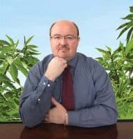 Dr Meletis with background of hemp plants for hemp education